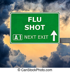 FLU SHOT road sign against clear blue sky