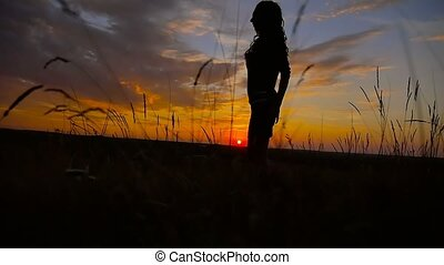 girl goes on a sunset in the sun slow motion video - girl...