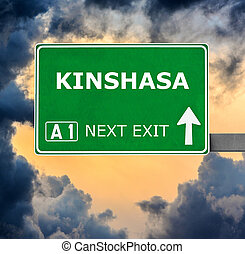 KINSHASA road sign against clear blue sky