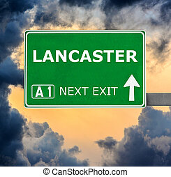 LANCASTER road sign against clear blue sky