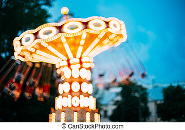 Abstract Motion Blur Image Of Illuminated Carousel Amusement...