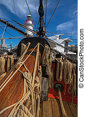 Coiled ropes and bowsprit at foredeck of Tall Ship HMB...