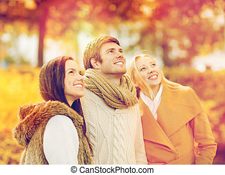 group of friends having fun in autumn park - summer,...