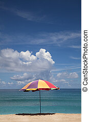summer time on beach and umbrella