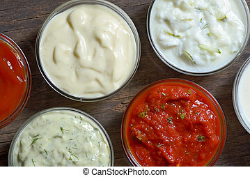 Differnt sauces for fast food on wooden table