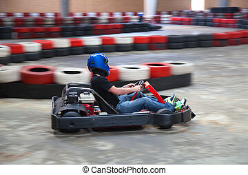 Kart - Racing go-kart on indoor track