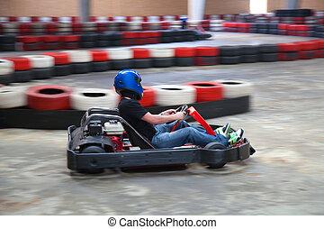 Kart - Racing go-kart on indoor track
