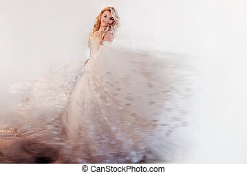 Beautiful girl bride in a magnificent dress, abstract soft background