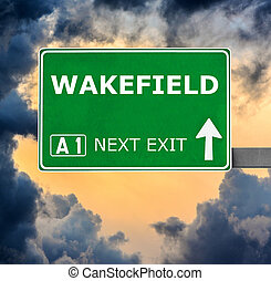 WAKEFIELD road sign against clear blue sky