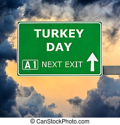 TURKEY DAY road sign against clear blue sky