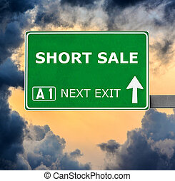 SHORT SALE road sign against clear blue sky - SHORT SALEroad...
