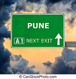 PUNE road sign against clear blue sky