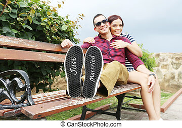 Young beautiful couple with message quot;Just marriedquot;...