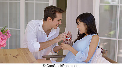 Man proposing a marriage to woman with ring - Excited young...