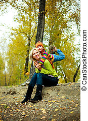 mother and son outdoor - young mother and her son outdoor in...