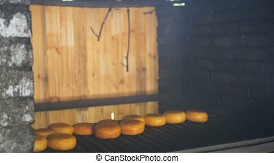 Smoked cheese on the oven, the cooking process National dish...