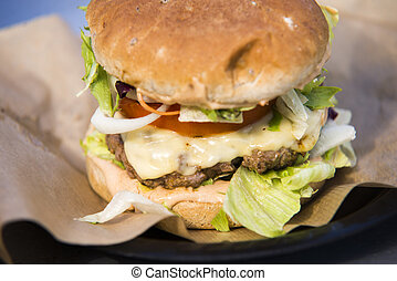 close on fast food unhealthy burger on paper