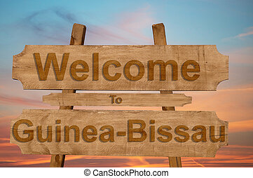 Welcome to Guinea Bissau sing on wood background