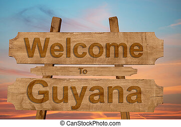 Welcome to Guyana sing on wood background