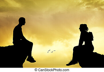 man and woman sitting on the summit