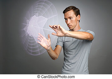 Man working with interactive Sci-Fi HUD interface - Young...
