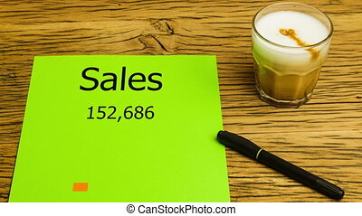 Sales chart animating on desk - Sales chart animating on...