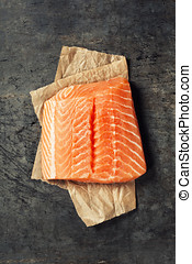 Salmon Fillet - Raw salmon fillet in a rustic style Top view...