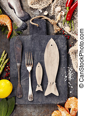 Delicious fresh fish and seafood on vintage background. Fish...