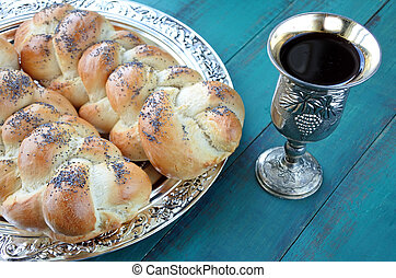 Uncovered challah bread and Kiddush wine cup - Overhead view...