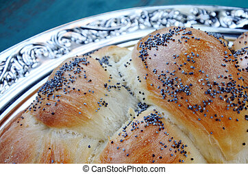 Close up of uncovered challah bread - Close up details of...