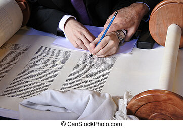 Sofer completing the final letters of sefer Torah - Person...