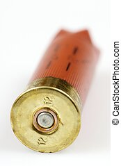 shotgun shell - forefront of a red shotgun shell with white...