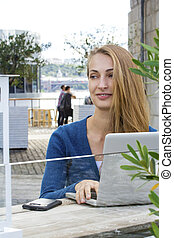 Woman with laptop outdoors. - Happy blond Woman with laptop...