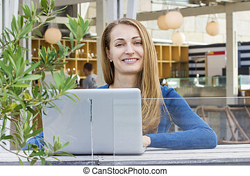 Woman with laptop outdoors - Happy blond Woman with laptop...