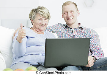 Saying yes to technology - Portrait of a happy senior woman...