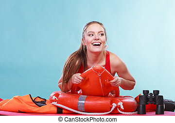 Happy lifeguard woman lying on rescue ring buoy. - Happy...