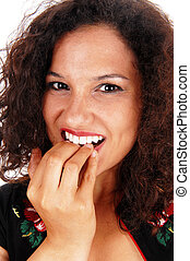 Woman biting her nails - A closeup of the face of a young...