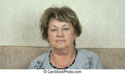 Portrait of adult woman with serious look staring at camera