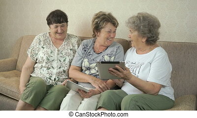 Old women talking with each other at home