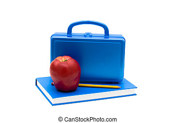 School Lunches - Blue lunch box and apple on a blue book...