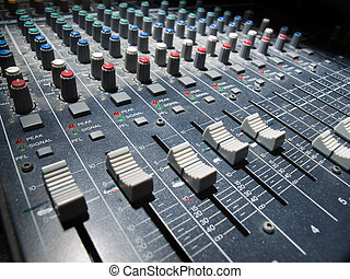 Soundboard - Sound mixer, low angle shot with shallow DOF,...