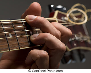 Guitar chord - man playing chord on the acoustic...