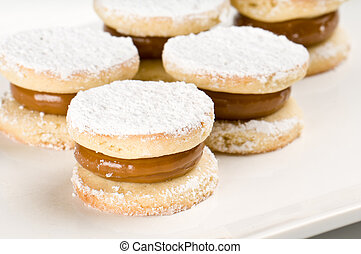 Argentinean Alfajor - Close up of cornflour cookies filled...