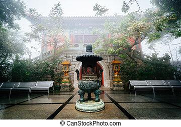 Historic building in fog, at Ngong Ping, Lantau Island, Hong...