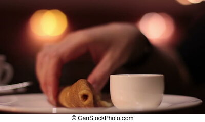 Woman eating pancake in cafe hands closeup - Woman dunks and...