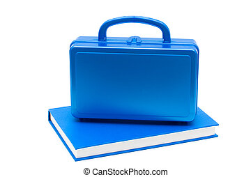 School Lunches - Blue lunch box with a blue book isolated on...