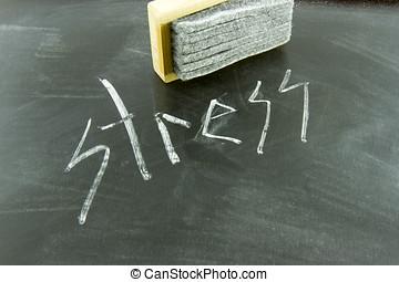 Erasing stress - Stress written in white chalk on blackboard...