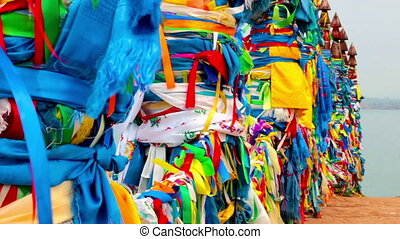 Serge. Sacred poles with colored ribbons in island Olkhon....