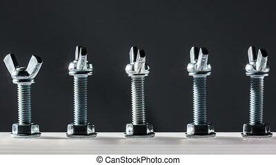 row of screw with caps