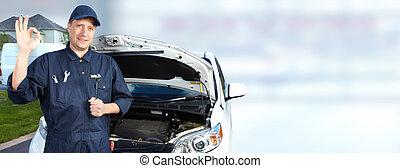 Smiling car mechanic in auto repair service. - Smiling car...